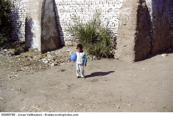 A kid with a blue balloon in Luxor Egypt