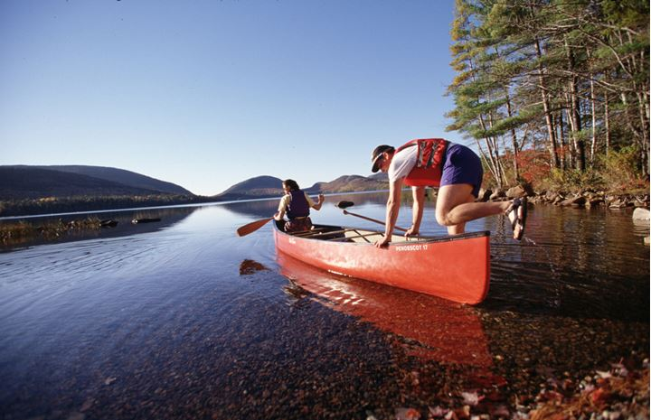 A man getting into a canoe
