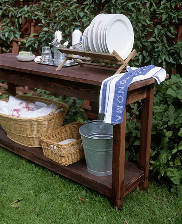 A table with kitchenware outside