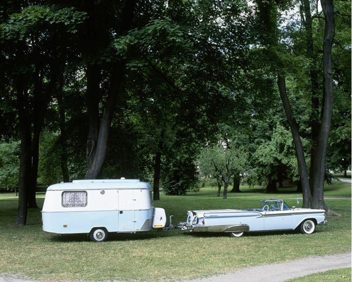 An old american convertible and trailer