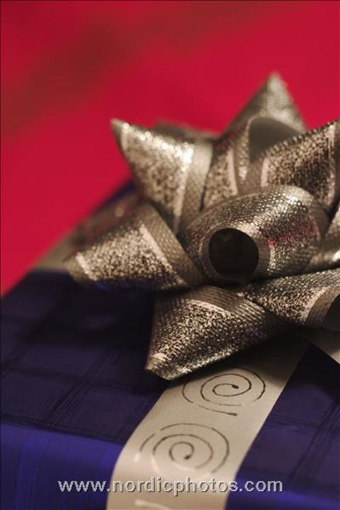 Close-up of a Christmas present decorated with ribbon