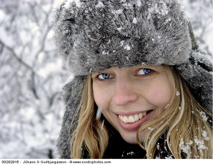 A woman with a fur hat in the snow, Reykjavík, Iceland