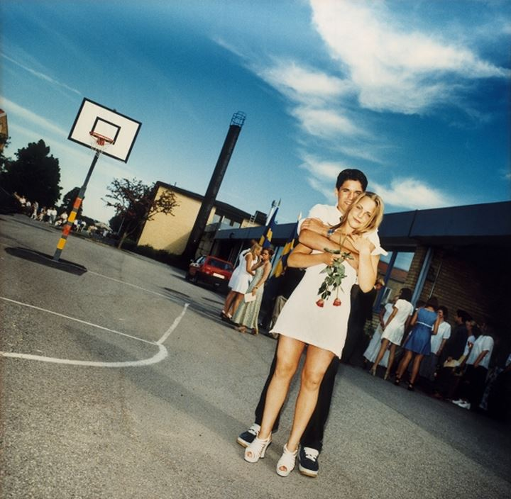 A couple on a basketball court