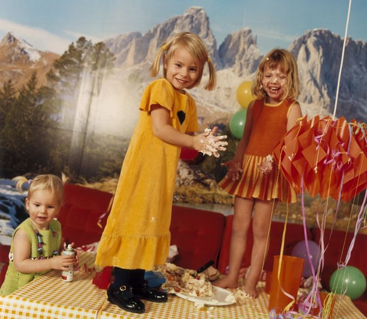 Little girls playing with food at a birthday party