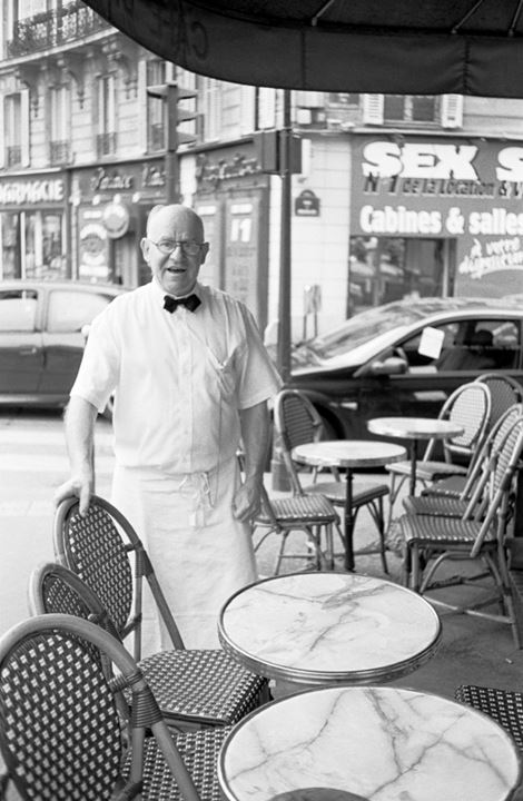 A waiter near Moulin Rouge in Paris