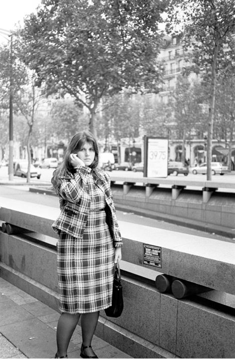 A woman at avenue des Champs Elysees in Paris