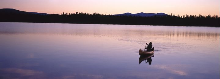 Canoeing on a still lake