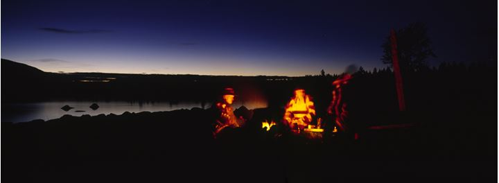 People around the fire on a river side