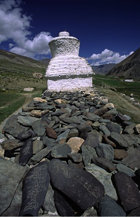 Wall of mani stones with chorten