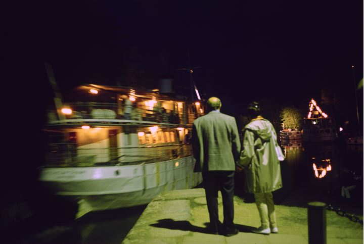 Couple looking at a yacht that has just left