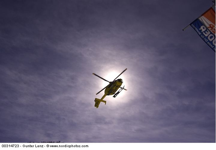 A helicopter against the sun