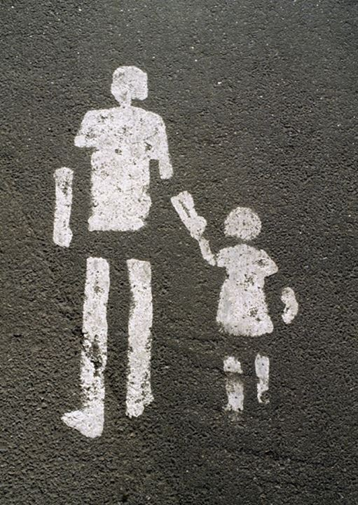 The sign of a crosswalk stencilled on a wall