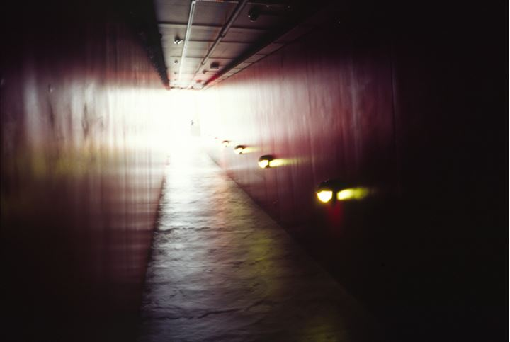 Red corridor with yellow lights