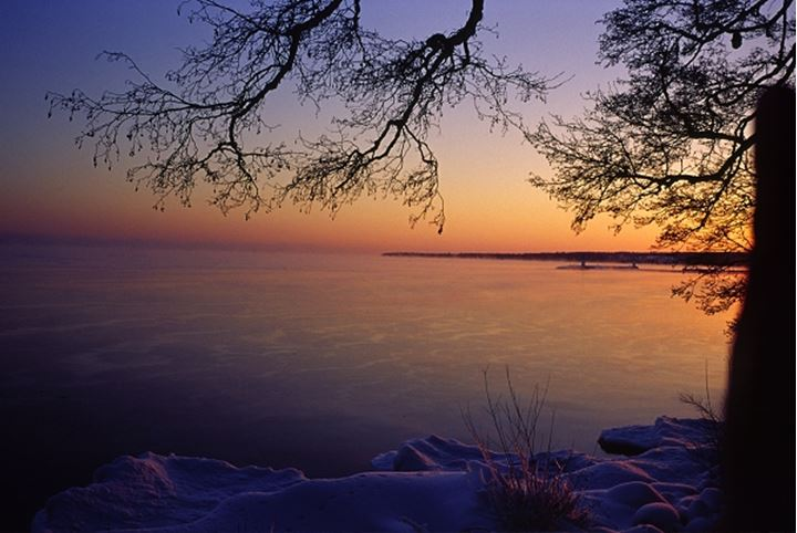 View of a frozen lake at sunset