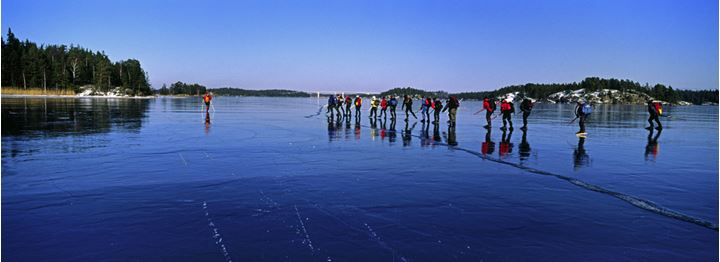 People skating on a frozen lake