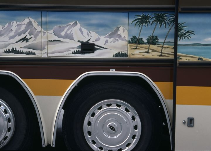 Pictures over wheels of a coach