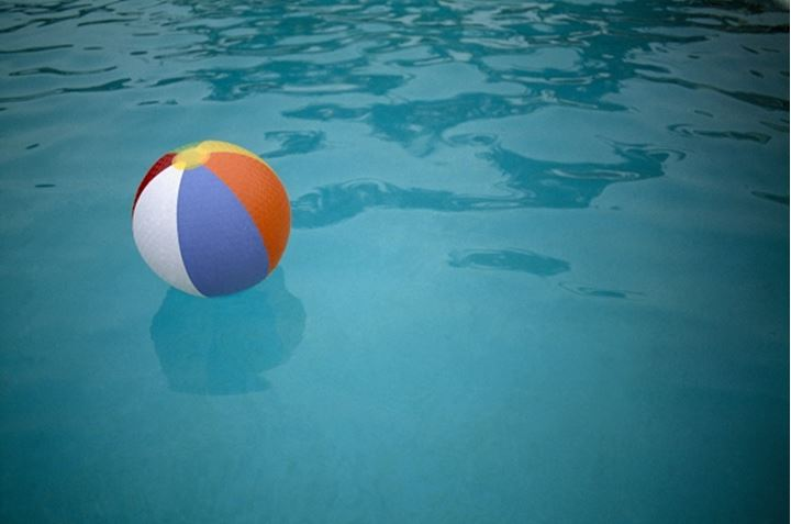 High angle view of a colorful beach ball floating on water