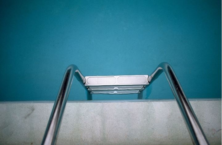 High angle view of a step ladder at a swimming pool