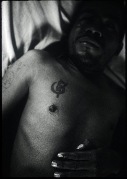 A man with a tattoo on his chest