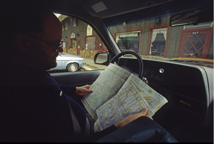 A driver looking at a map