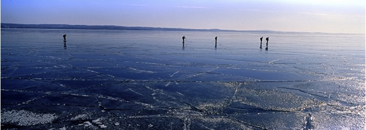 People walking on a thawing lake