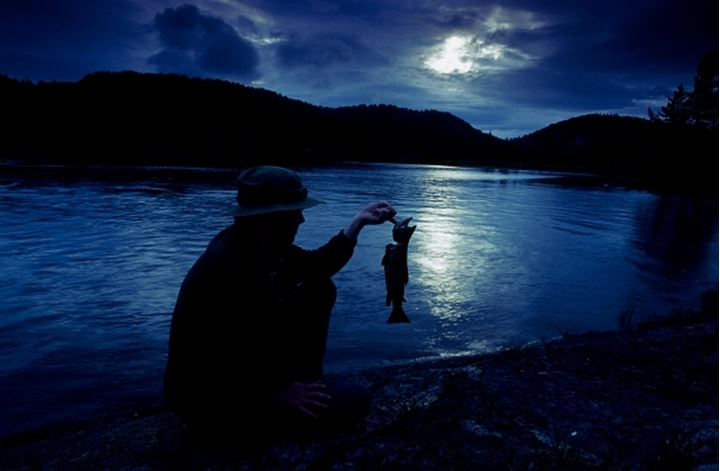 A fisherman holding a fish
