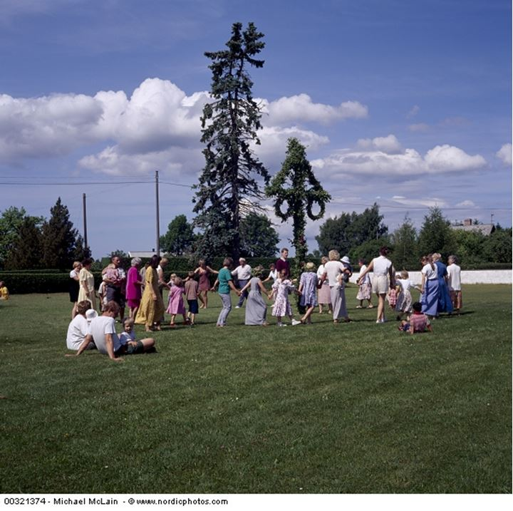 People dancing around maypole during midsummer celebration