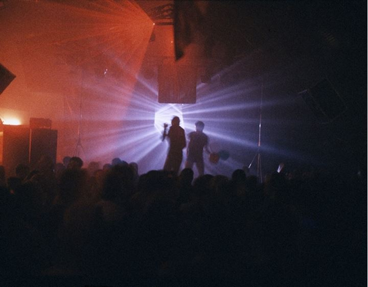 Silhouette of performers in a nightclub