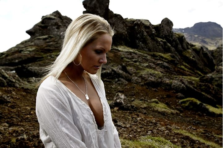A blonde woman in rocky landscape, Iceland