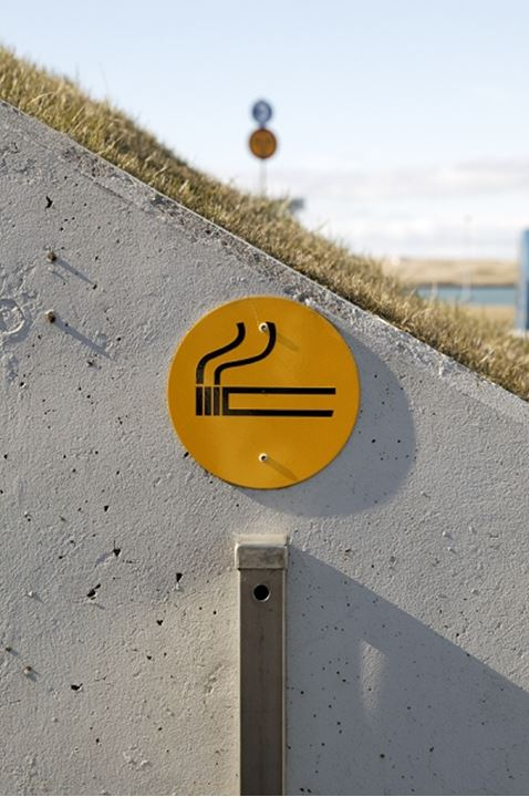 A special place where it's allowed to smoke, with a metal container for cigarette butts