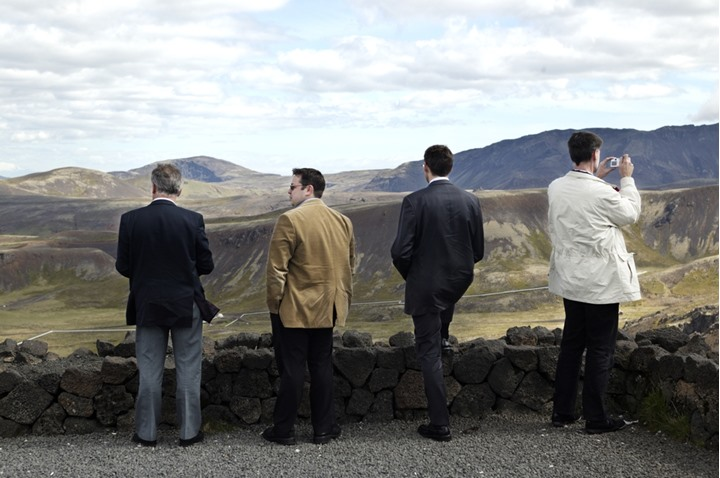 Men against a picturesque mountain landscape, Nesjavellir, Iceland