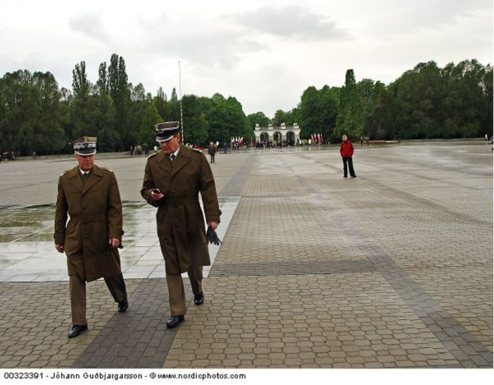 Two officers walking on a square