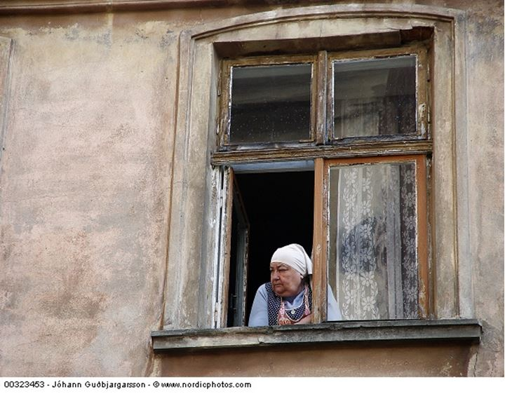 A woman looking out of a window