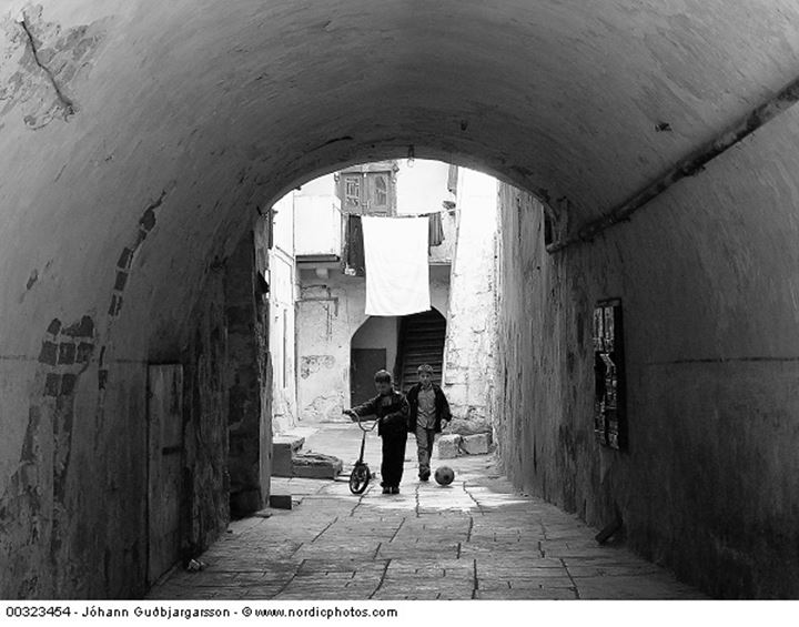 Two boys at an archway