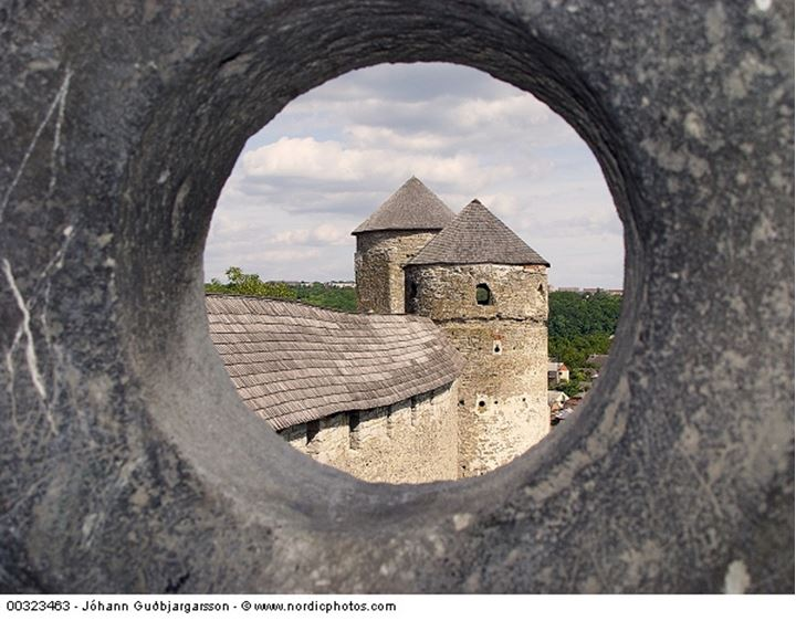 View of a medieval tower through a hole