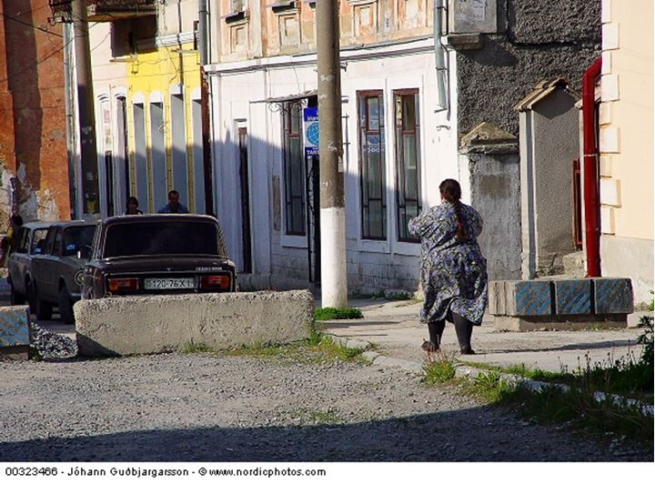 A fat woman walking on the pavement, Ukraine