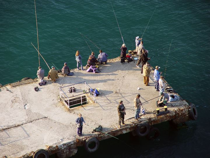 People fishing from a wharf