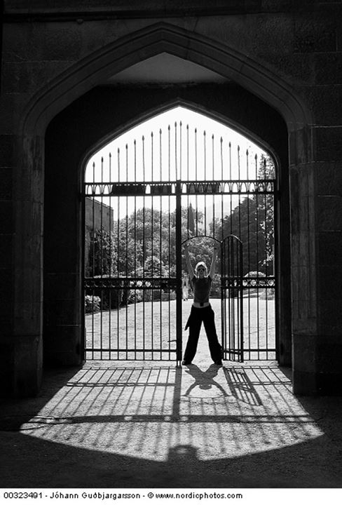 A person standing in a gateway
