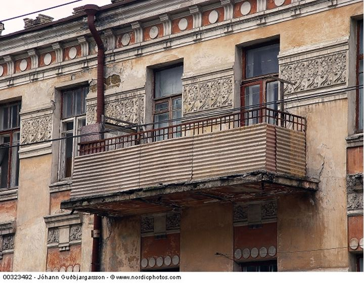 A balcony of an old house