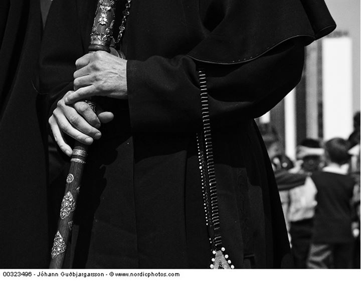 A sabre in hands of a priest