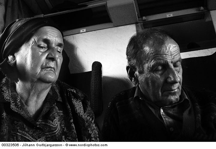 Elderly man and woman with closed eyes