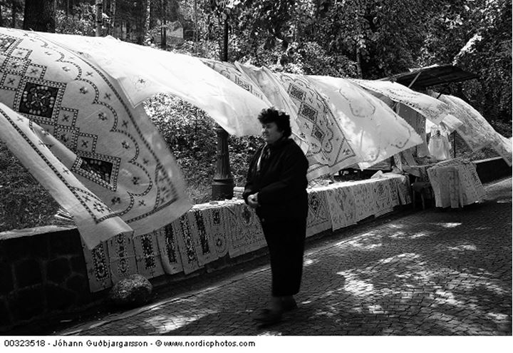 A woman selling textiles