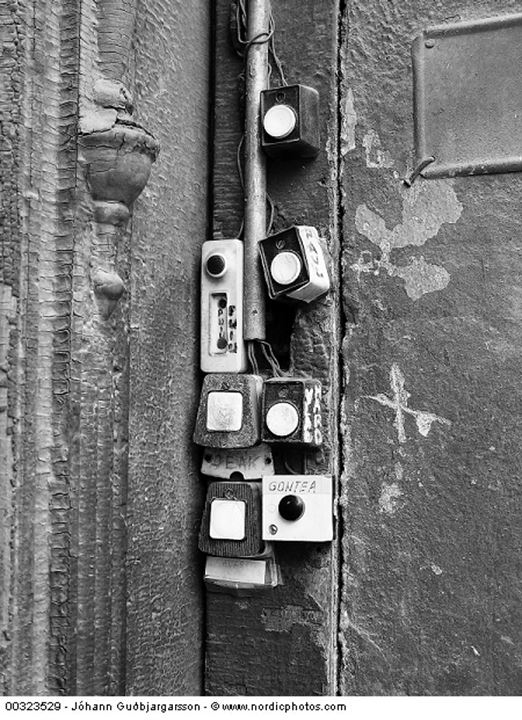 Close-up of switches of doorbells