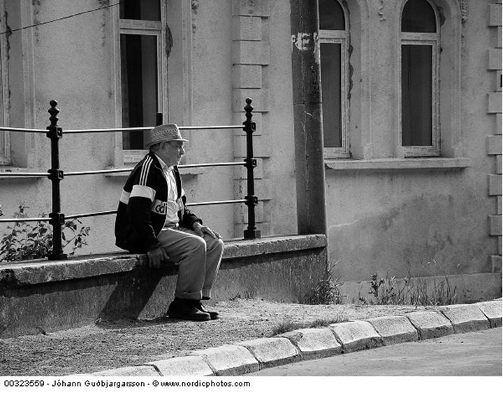 An elderly man taking a short rest