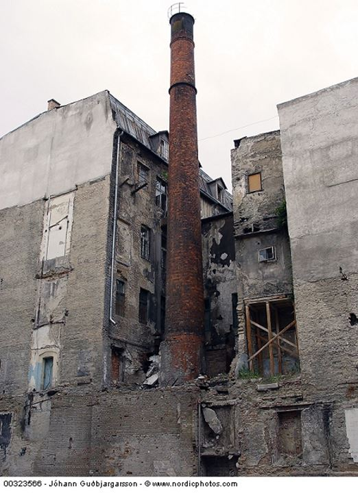 A rusty chimney and a ramshackle house