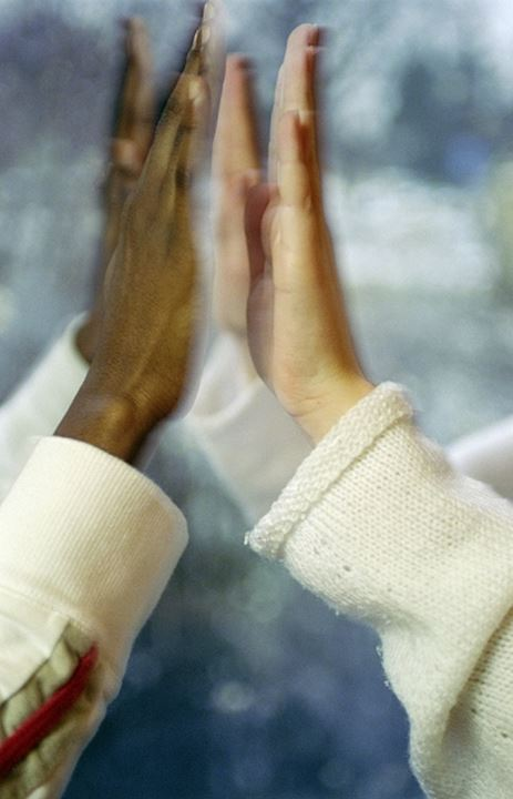 Hands approaching each other