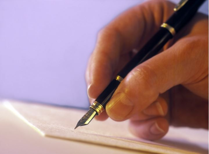 hand with a pen - signature