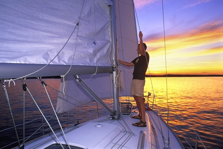 A man on his boat during sunset
