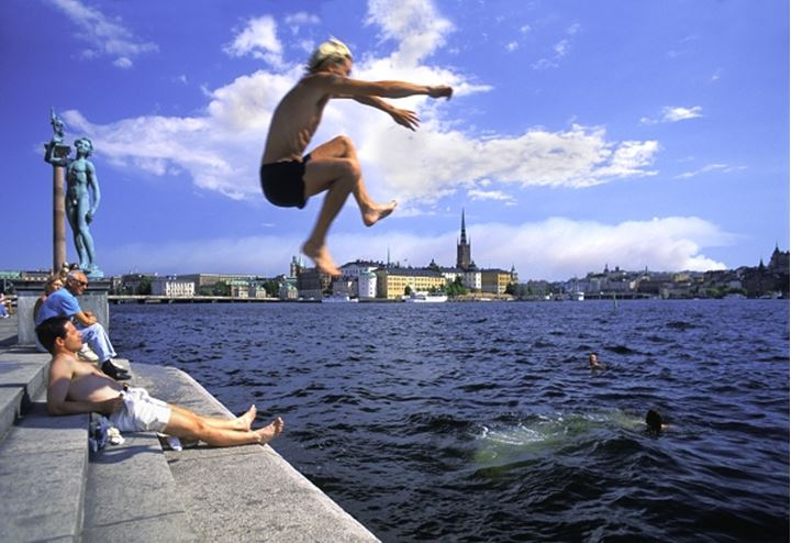 Young people jumping in Lake Malaren, Stockholm, Sweden