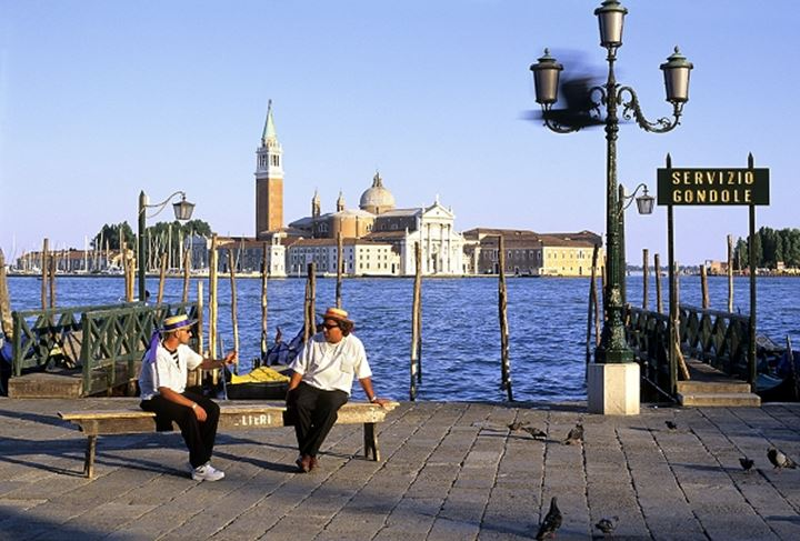 Couple sitting on a bench, Venice, Italy